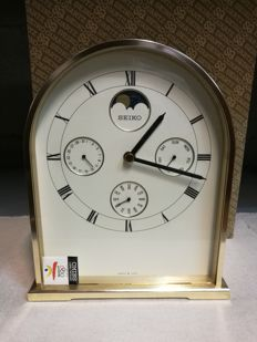SEIKO table clock from the 1990's, in brass, with Roman numerals, date display and moon phases