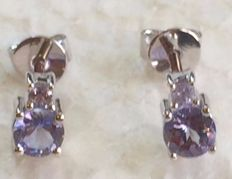 14 kt white gold round  tanzanite earrings set with a single stone  5 x 5 mm