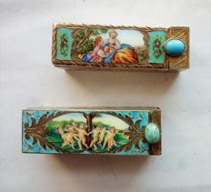 Pair of classical style lipstick case in silver and enamels, 1940s