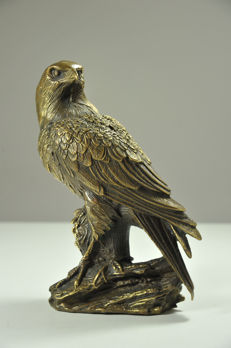 Bronze falcon on a brench