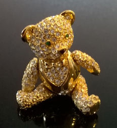 Joan Rivers, tuxedo teddy bear brooch