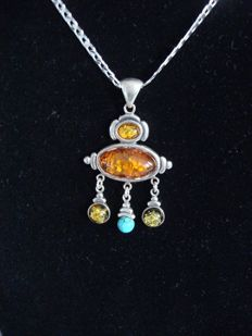 Vintage silver pendant with multicolour Baltic amber on a long, heavy necklace.