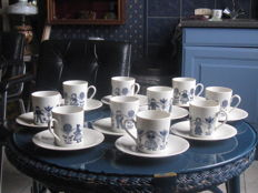 69 pieces of Dutch porcelain tableware depicting traditional costumes