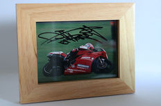 Nice framed image, personally signed by Carl Fogarty