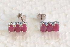 14 kt white gold  Ruby  earrings set with 3 x single stones ; size 5 x 5 mm
