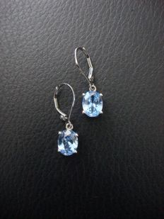Vintage silver ear studs, set with sparkling sky-blue Topazes