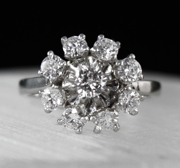 White gold 18 kt cluster engagement ring – Center brilliant diamond 0.20ct , & 8 smaller Diamonds for a total diamonds weight of 0.84ct.