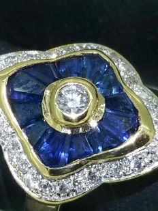Beautiful ring with calibrated sapphires and diamonds