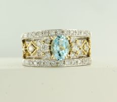14 kt bicolour gold ring set with 1.00 ct topaz and 34 brilliant cut diamond, approx. 0.62 ct, ring size: 17 (53)