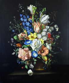 Continental school (20th century) - A still life of a vase of flowers