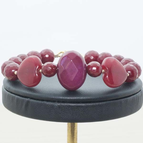 Ruby bracelet with clasp and beads in 18 kt gold
