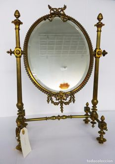 Neoclassical vintage mirror made of bronze and gilded metal, 1930s.