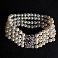 Beautiful Four-Strand Bracelet with 112 Genuine Japanese Akoya Sea Salt Water Pearls set with 18Kt. White Gold Large Clasp With Diamond and Sapphires . Excellent condition.