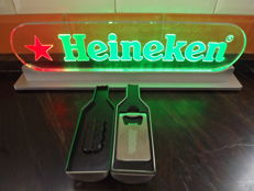 1 Light Heineken Signal and 2 Heineken open bottle.