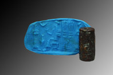 Black Stone cylinder seal with offering scene - 1.8 cm