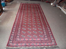 New. Hand-knotted, red Bukhara Turkman Never used.Runner 3.30 x 1.40 cm