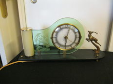 Antique electric clock with lighting with bronze deer from the 50s.