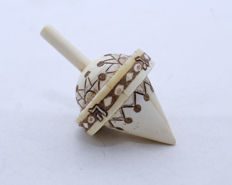 A carved bone cone shaped spinning top or Dreidel - Hannukah - Germany - circa 1920