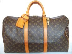 Louis Vuitton  Keepall 50 + LV accessories + LV padlock (315) with 2 keys - **No reserve price**