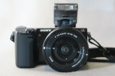 Sony NEX 5R digital camera (2012) with Sony lens SELP 1650 (2012), Sony Akku (2017) and bag (2013)