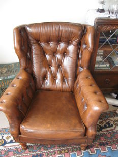 Brown, quilted Chesterfield style wing chair, England, circa 1980