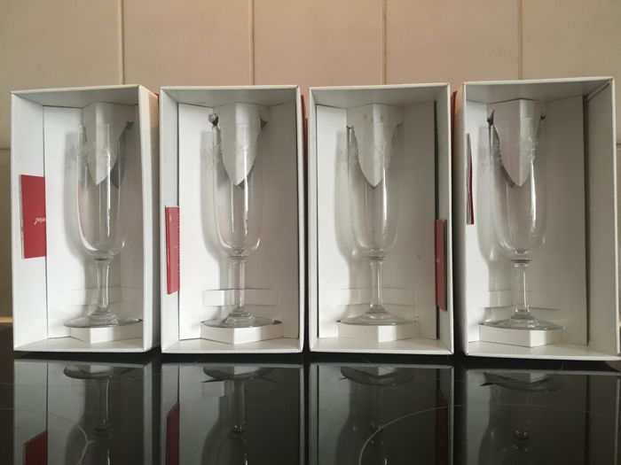 4 Champagne flutes made by Baccarat