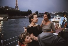 David Alan Harvey (1944-) - French teenagers on a boat in the river Seine near Paris, France, 1988