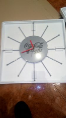 Coca Cola light clock with the shape of a giant sun