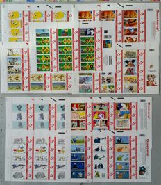 "Belgium - 18 different complete sheets of Duostamps, all with pattern ""strips of cartoon"""