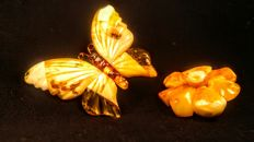 Two vintage old Egg yolk colour brooches. Butterfly and Flower made of 100% Natural Baltic Amber, ca. 18 grams