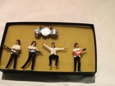 "Set of 4 lead figures of The Beatles entitled ""The Beatles at the Shea Stadion"" in its original box."