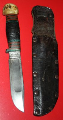 Wade & Butcher knife with leather sheath, good condition, nice clear stamps.