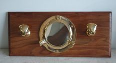 Cabin coat hanger with porthole in brass and teak