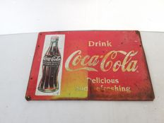 Old tin Coca Cola sign from 1955