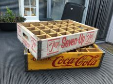 "Two old crates, one of ,,Coca Cola"" and one of ,,Seven Up"" from the 1960s"