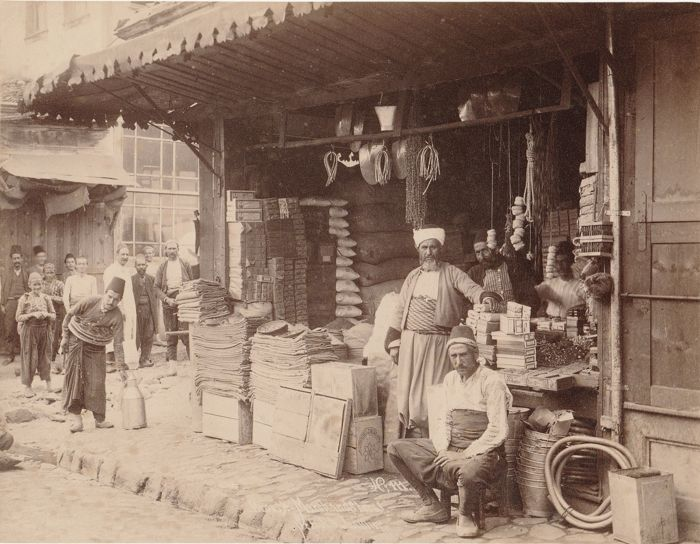 Sebah and Joaillier (19th century) - Booth and merchant with passers-by, Constantinople, Turkey