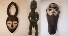 From the estate of a collector - 3 pieces- Old statue of a fortune teller - Africa, 2 old masks - Africa