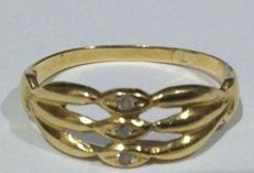 Ring of 18 kt gold. Size: 15 mm.