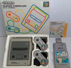 Boxed Super Nintendo console (Japanese import) with universal power supply, 2 controllers, Super Game Boy  and 3 games