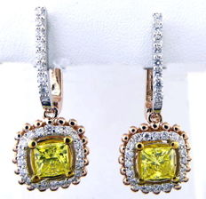 Earrings in 14 kt, bicolour gold - two fancy, intense yellow colour diamond, 1.20 ct and 56 brilliant cut diamonds, 0.50 ct.