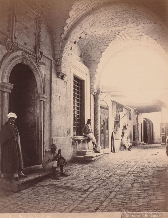 J.Kuhn (act 1885/1905) - Street booksellers of the medina of Tunis, Tunisia