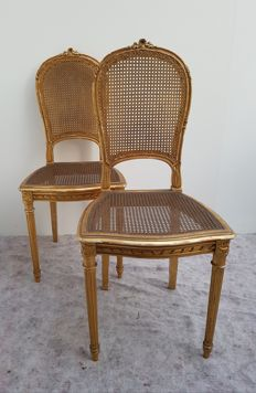 "A set of Napoleon III gilt wood salon chairs in Louis XVI style with wicker seat ""Krieger"" - France - late 19th century"