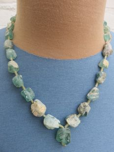 Strand of beads made of iridescent archaeological Roman glass of approx. 1,700 years old - 3rd–4th century.