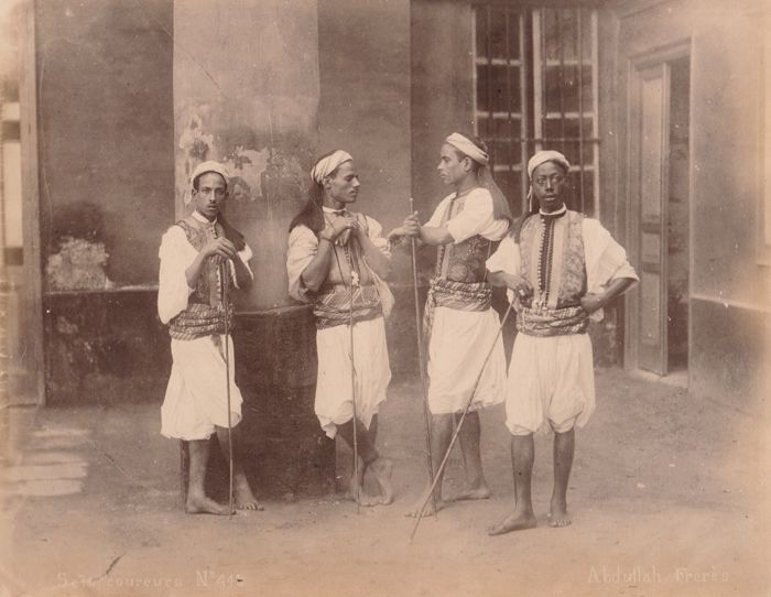 Abdullah Freres (active 1858 to 1899) - Seis runners in a house in Cairo, Egypt