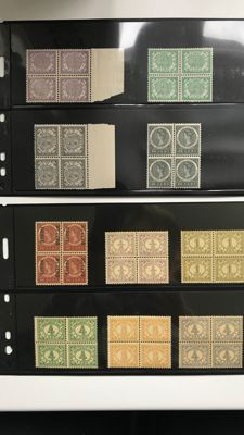 Dutch East Indies 1900/1935 Batch of mostly blocks of 4 on black sheets