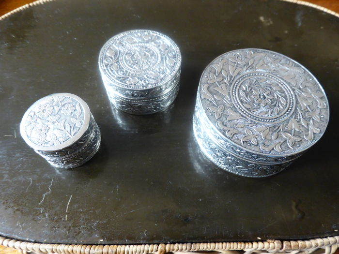 Three silver peppermint boxes with floral ornamental work