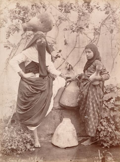 Attr Hippolyte Arnoux (active 1860-1890) - Woman carrying water and her daughter, Cairo, Egypt