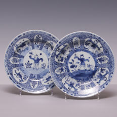1 Pair of blue and white porcelain bowls, decoration of fools in panels - China - 18th century