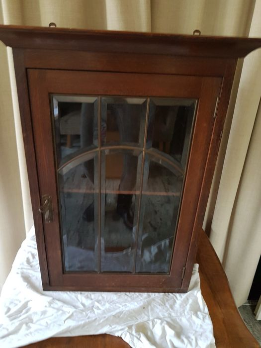 Oak hanging cupboard with facet cut stained glass window panes