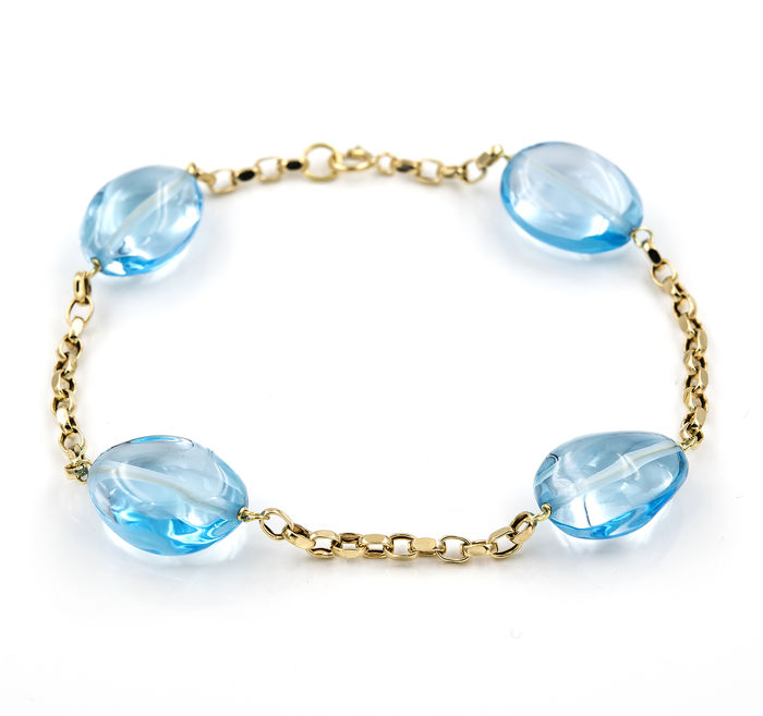 18 kt (750/000) yellow gold bracelet with blue topaz - Chain length: 19.5 cm